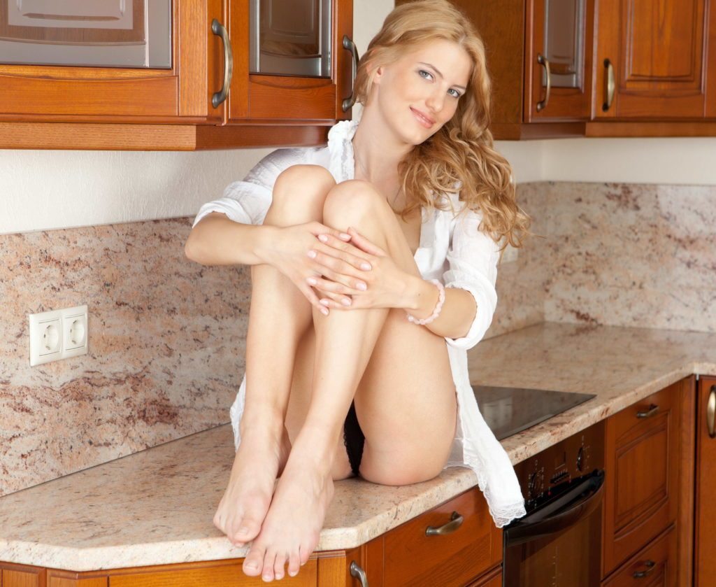 Stunning Lady On The Kitchen Counter
