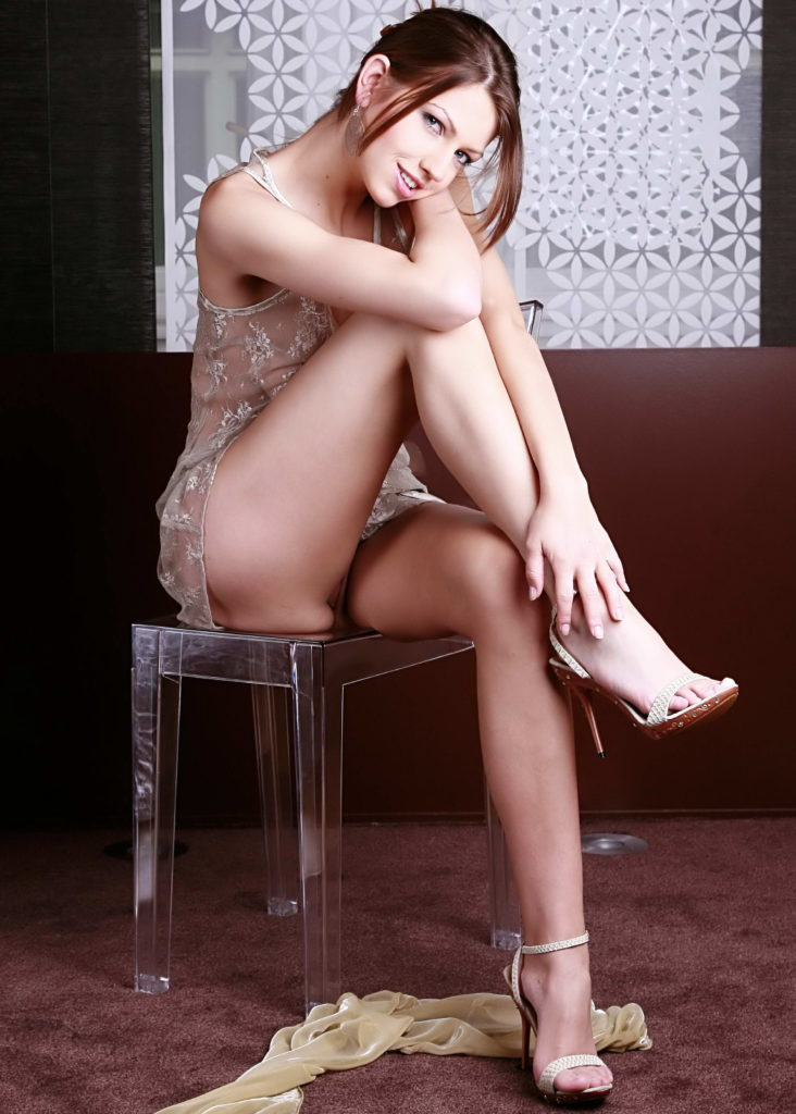 Sexy Brunette With Beautiful Crossed Legs